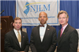 NLC President Mayor Anthony Williams (c) and Mayor Tim McDonough (l) greet a Conference attendee