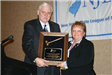 Mayor Pete Cantu presents award to outgoing NJLM president Mayor Jo-Anne Shubert