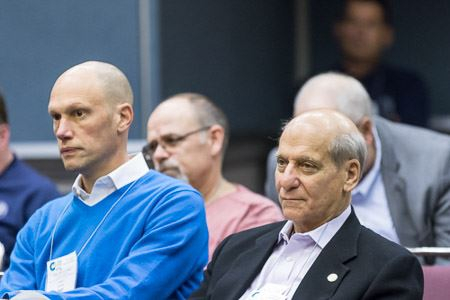 Men Listening in Audience