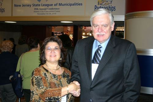 Margherita A. Kaplan, President of Registrar's Association of NJ and Mayor Pete Cantu mark the group's designation as a League affiliate organization