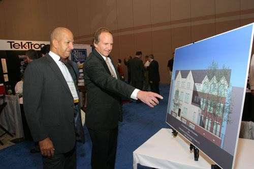 NLC Pres. Mayor Anthony Williams of Washington D.C. and William Dressel look at a drawing of NJLM's 222 West State Street headquarters