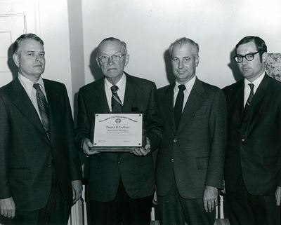 Bayard H. Faulkner receives an award