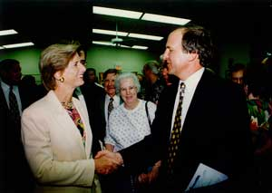Bill Dressel shaking hands with Governor Whitman