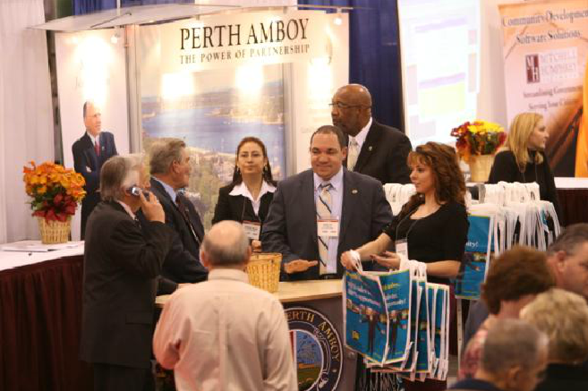 Perth Amboy Booth and Attendees Around Table