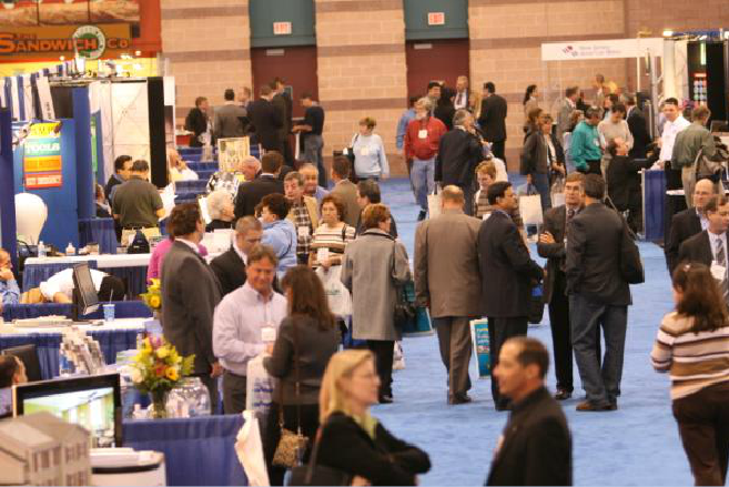 Conference Attendees Mingling in Aisle