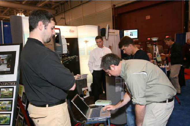 Men Standing Around Looking at a Computer