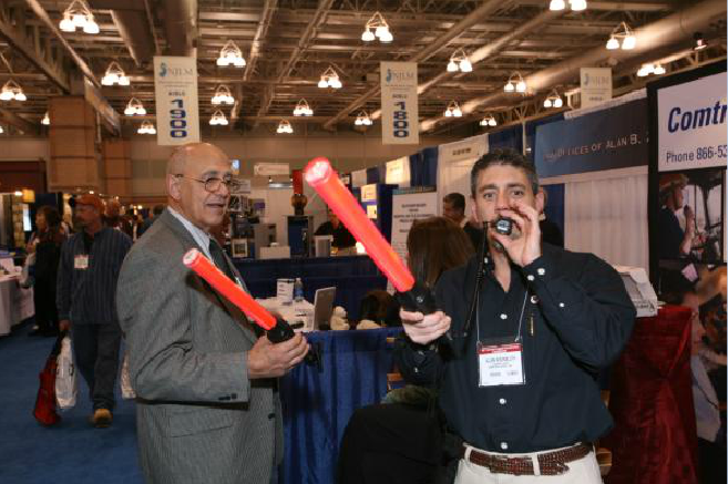 Two Men Playing With Booth Supplies
