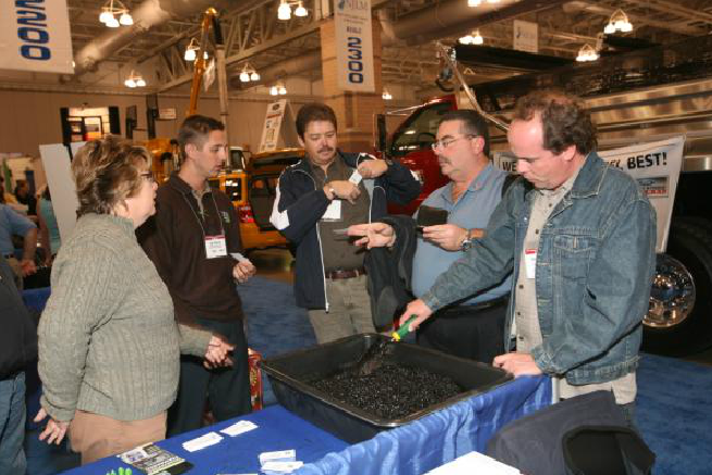 Five Attendees Analyzing Booth Supply