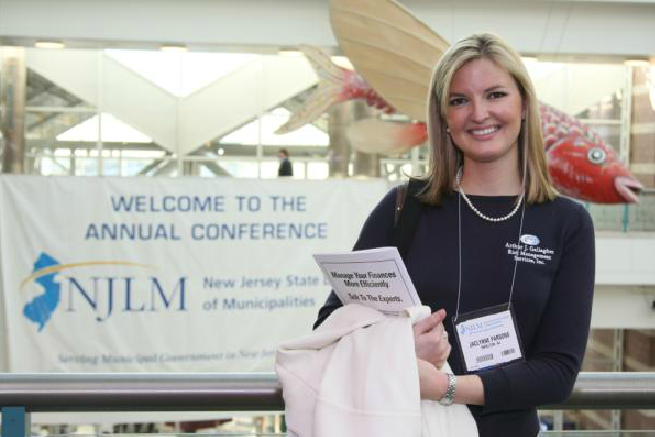 Woman Standing in Front of NJLM Banner