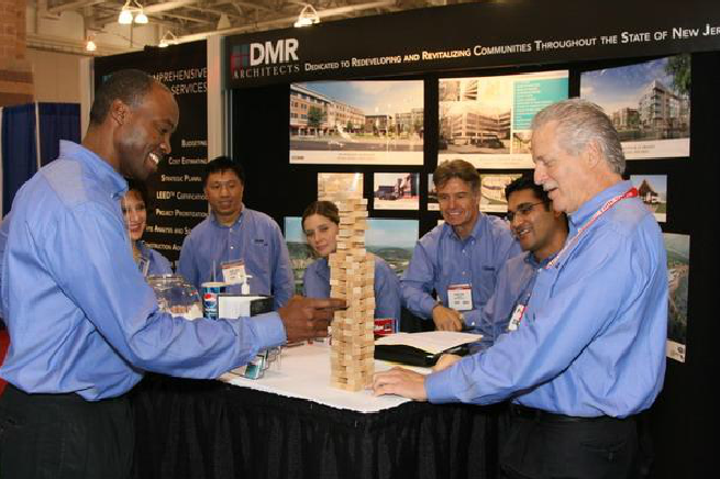 Booth Presenters Playing a Miniature Game of Jenga
