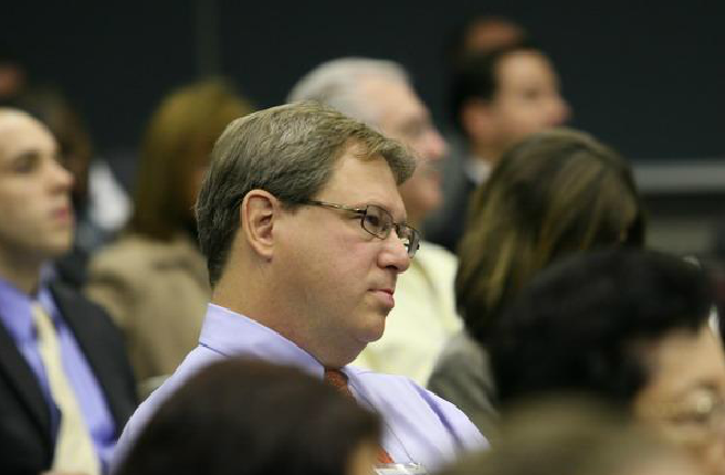 Man Listening Intently in Audience