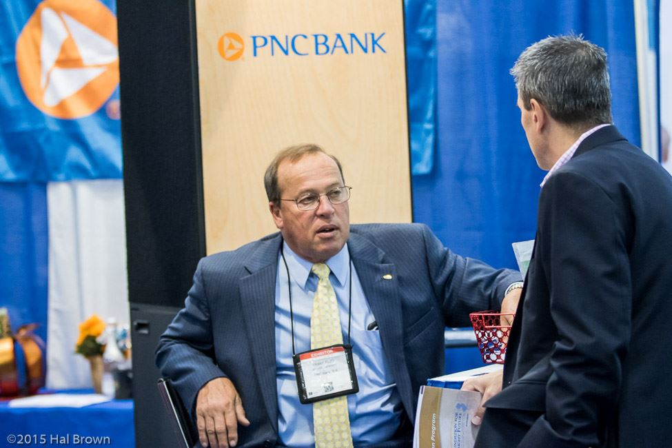 Men Speaking Near PNC Bank Booth