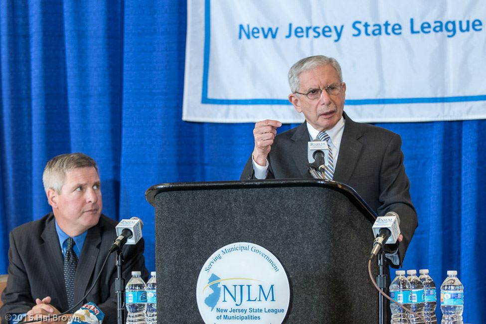 Man at Podium Speaking In Front of NJLM Banner