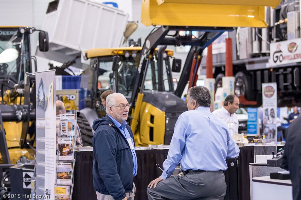 People Having a Discussion Near at Machinery Display