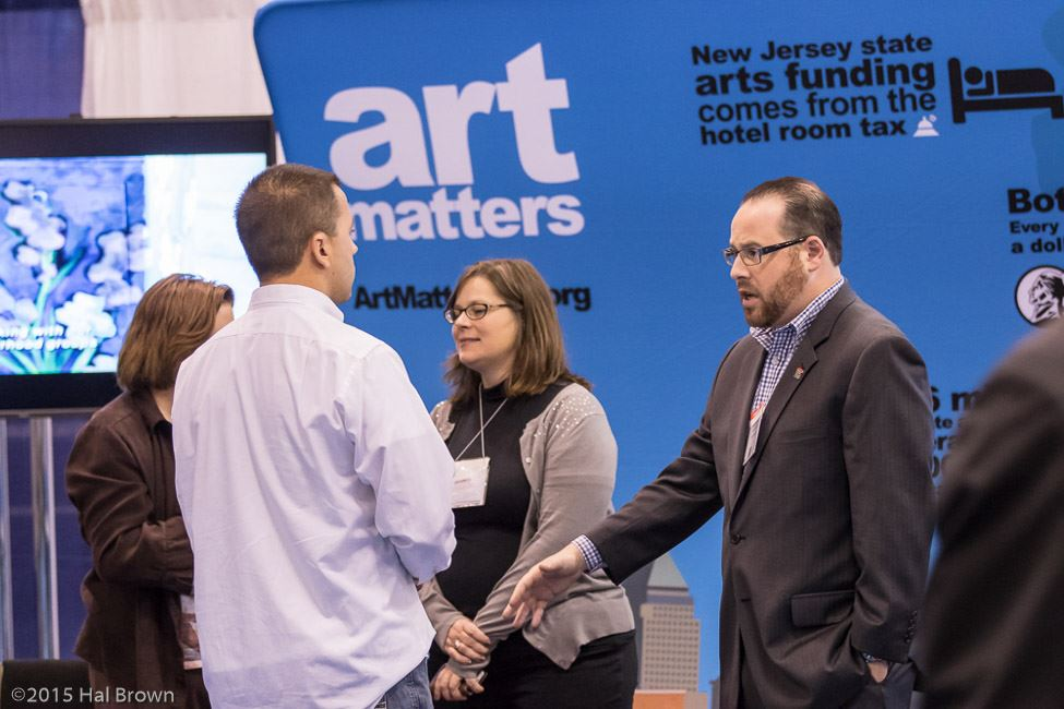 People Speaking Near Art Matters Booth