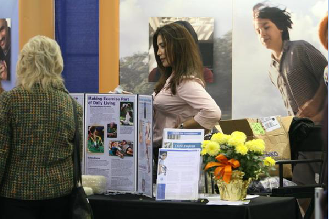 Woman Attendee and Woman Booth Presenter