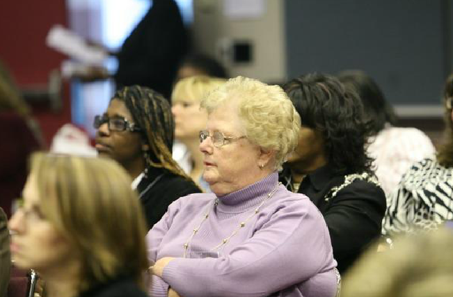 Women Watching Speaker from Audience