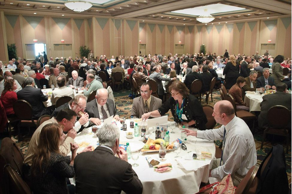 Officials Enjoy Lunch Break at Large Round Tables