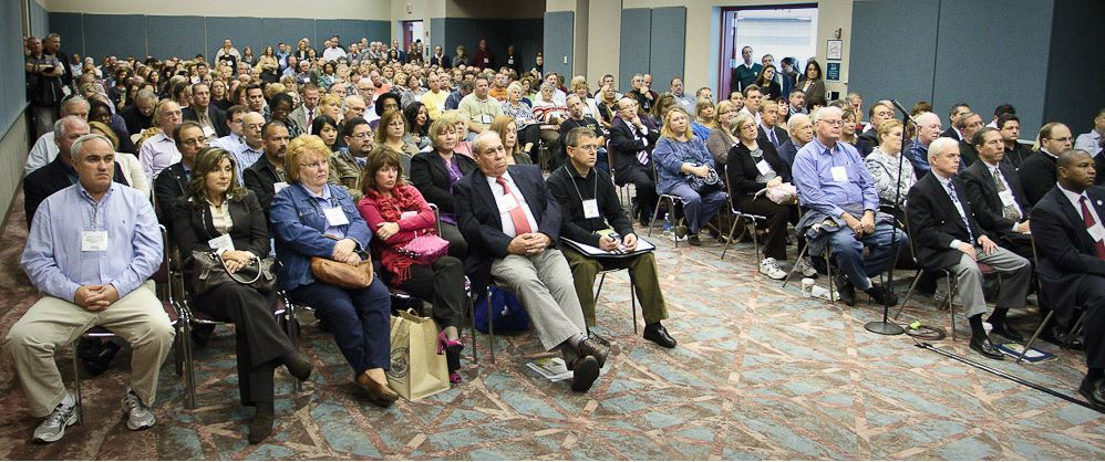 Seated Audience Listen to Speaker