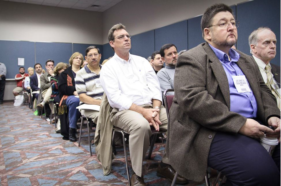 Seated Audience Members Listen to Speaker