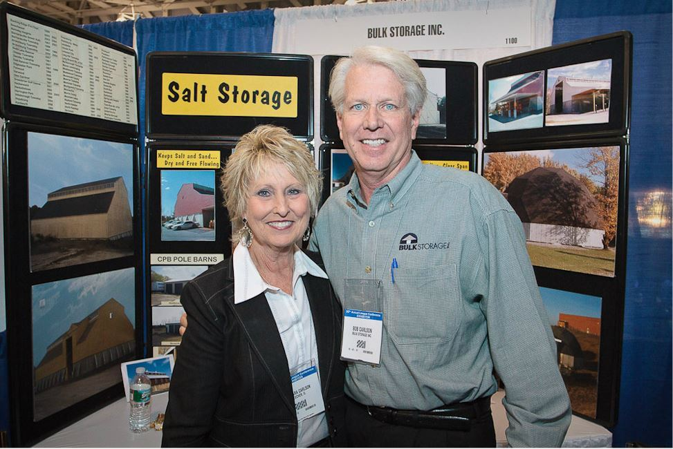 Woman and Man Smile Together for Photo at Bulk Storage Inc. Booth