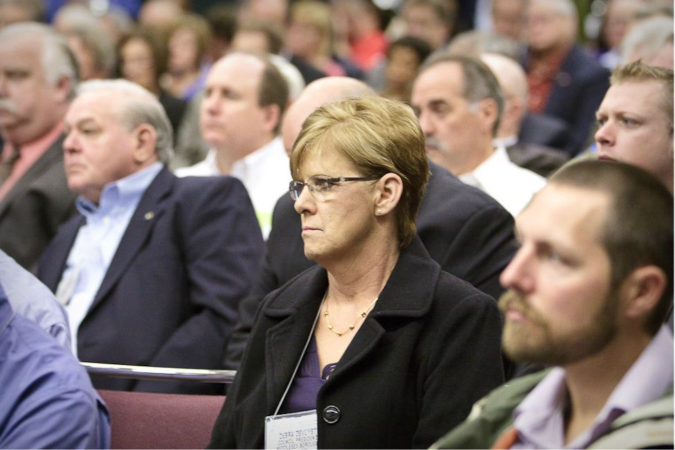 Woman in Audience Listens to Speaker