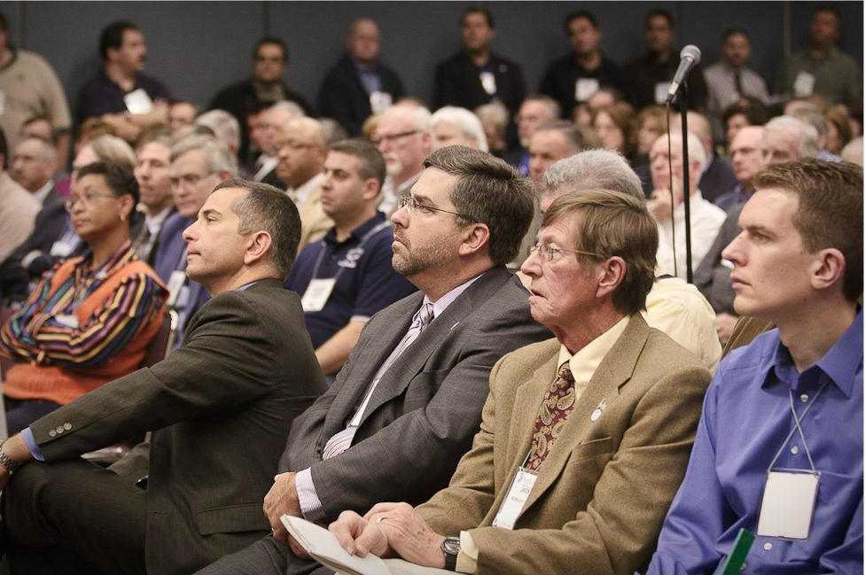 Audience of Conference Goers Listen to Speaker