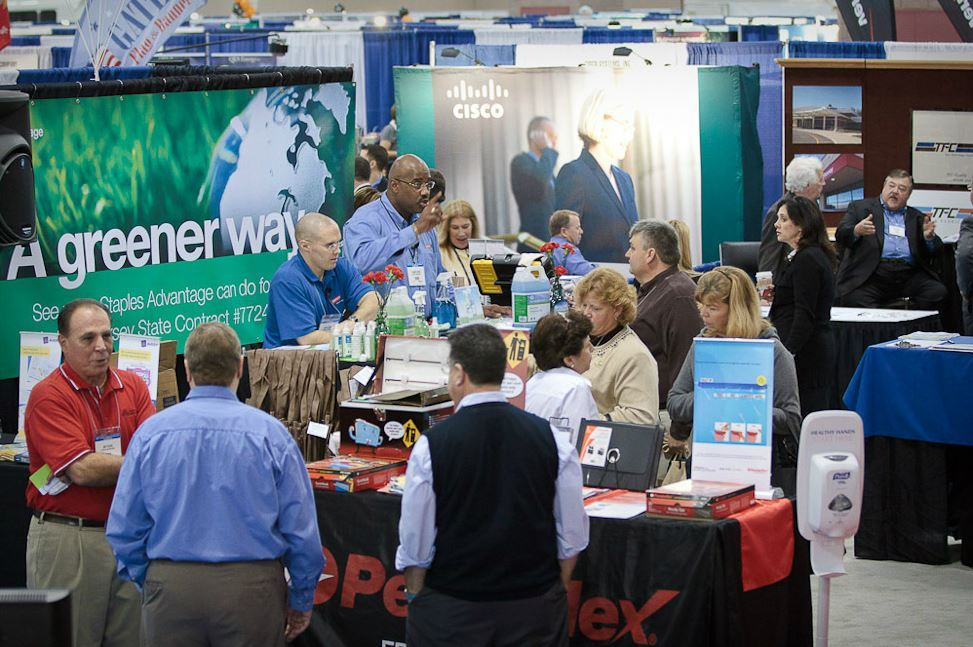 Conference Attendees Browse Exhibitor Booths