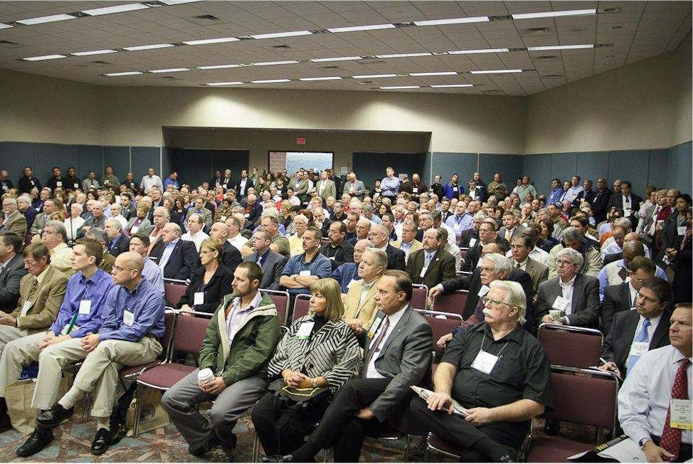 Conference Audience Listens to Speaker