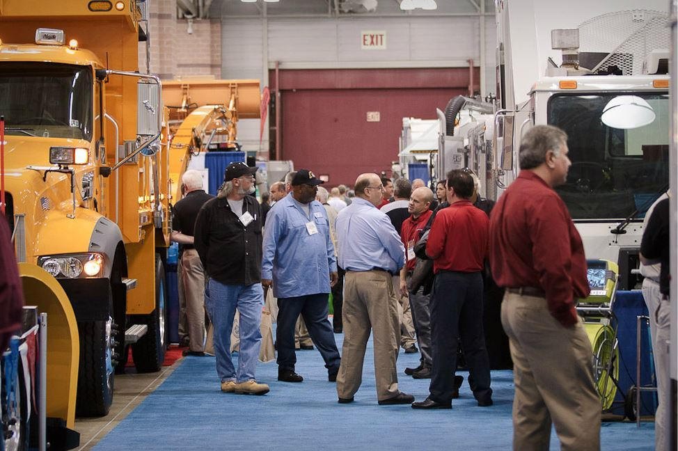 Conference Goers Meander Among Exhibit Booths