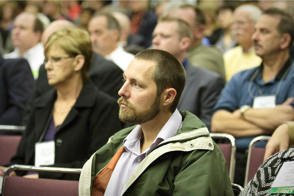 Man in Audience Listens to Speaker at NJLM Conference