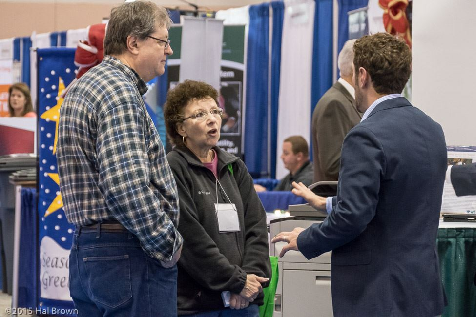 Exhibitor Speaking With Man and Woman