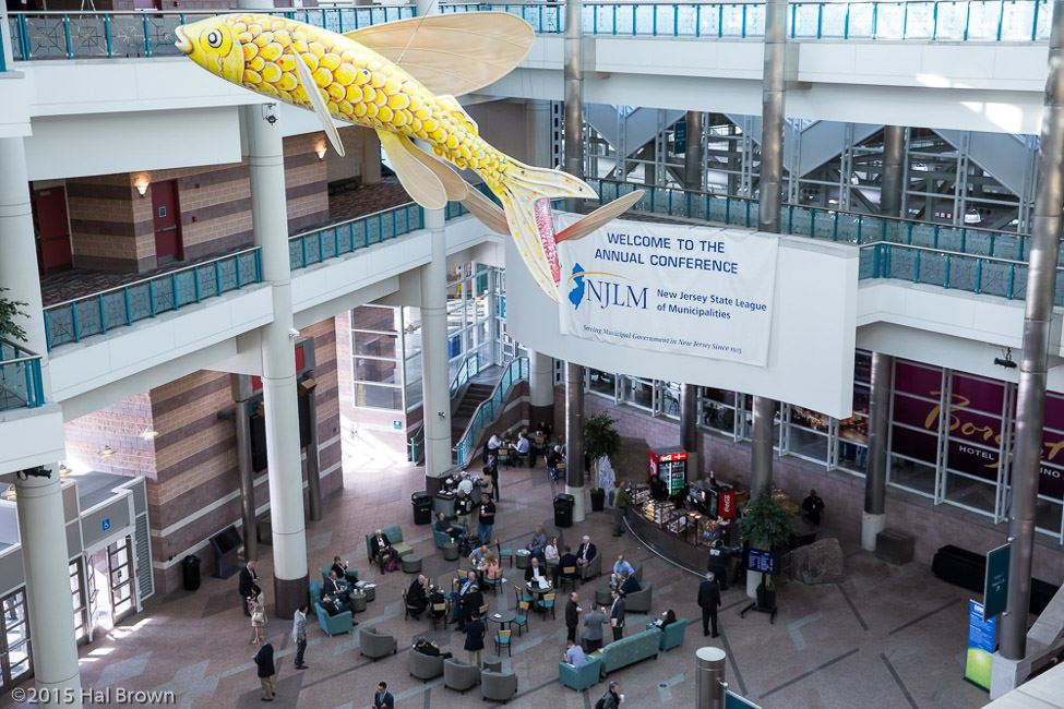 Large Atrium With Ornate Fish Art Hanging From Ceiling