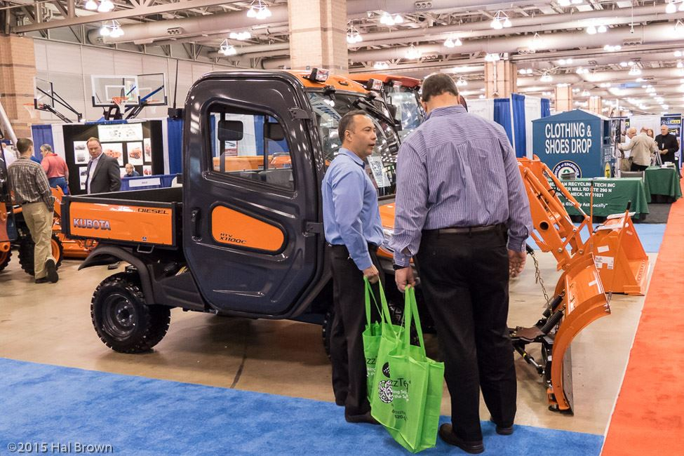 Men Standing by Orange Utility Vehicle