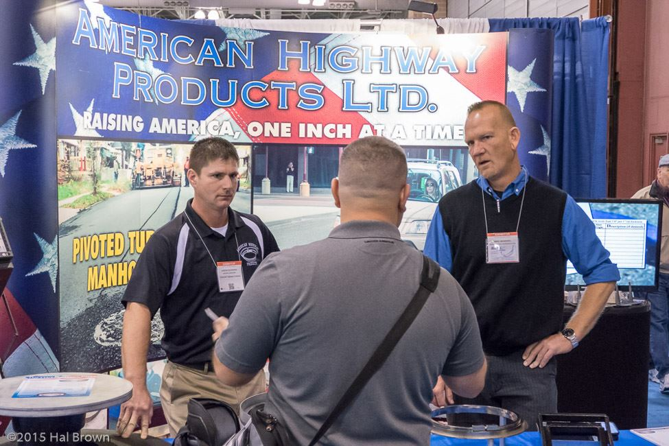 Men Talking at American Highway Products LTD Booth