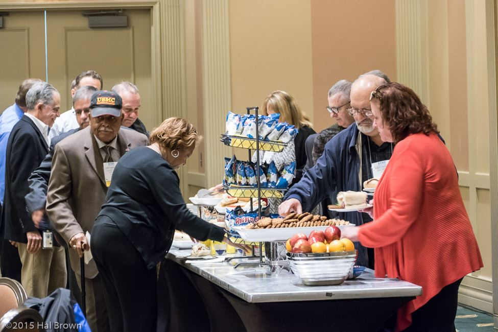 Men and Women at a Refreshments Table