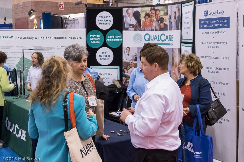 People Chatting by QualCare Booth