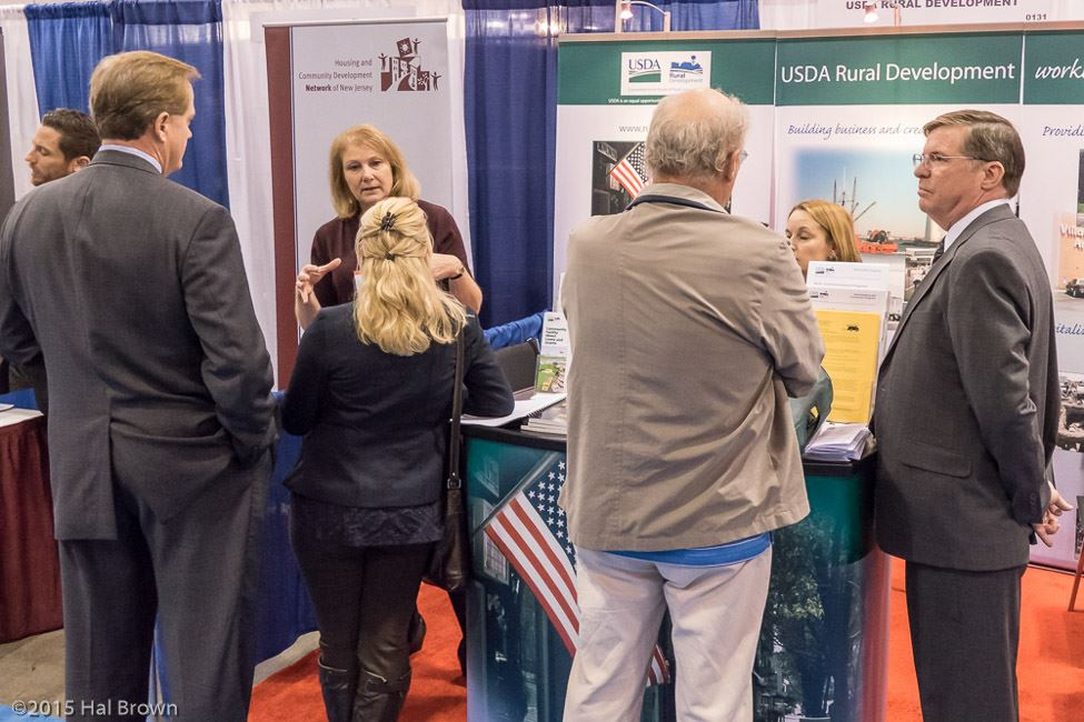 People Conversing at USDA Rural Development Booth