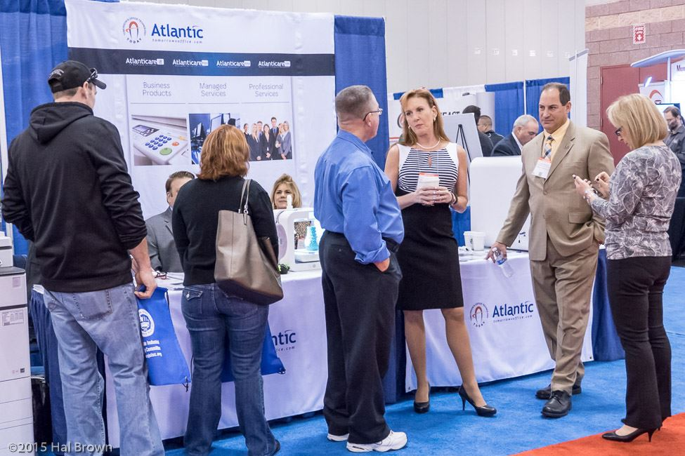People Conversing in Front of Atlantic Booth