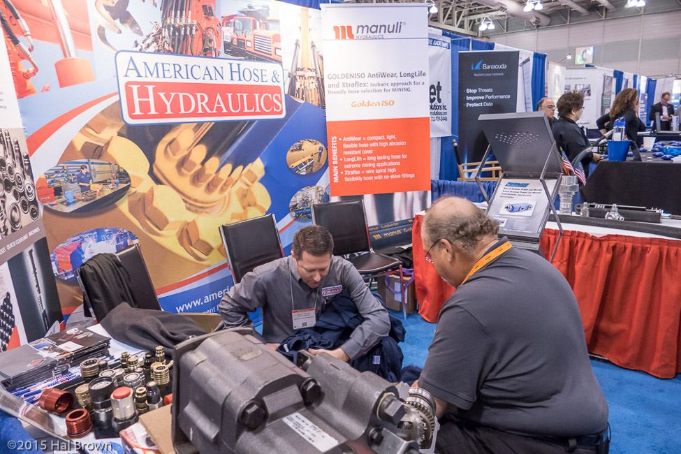 Two Men at American Hose and Hydraulics Booth