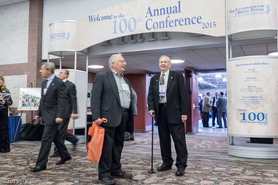 Two Men by the 100th Annual Conference Entryway