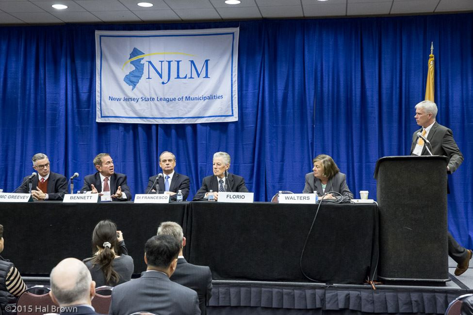 Speaker and Panelists in Front of NJLM Banner